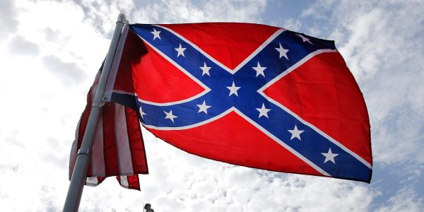 Marine Corps officially bans Confederate battle flag on military bases - including on bumper stickers and coffee mugs