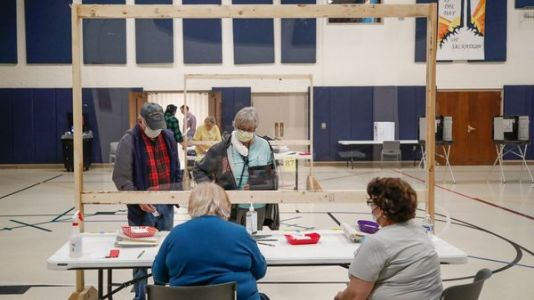 Long Lines, Masks And Plexiglas Barriers Greet Wisconsin Voters At Polls