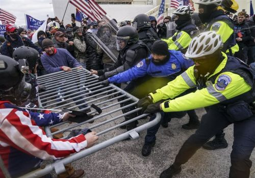 Newly released videos show fierce Capitol attacks on police on Jan. 6