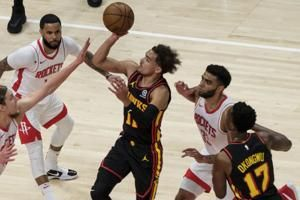 Hawks head to playoffs after 124-95 rout of woeful Rockets
