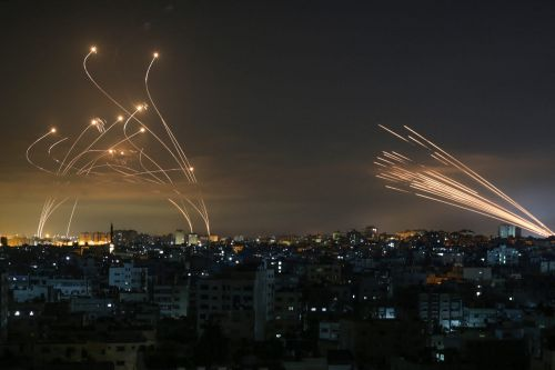 Dramatic photo shows Israel unleashing its Iron Dome interceptors as Hamas launches rockets from Gaza