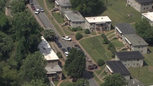 Armed person, police exchange gunfire at Spartanburg apartment complex, official says