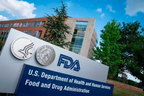 As COVID-19 cases surge, the FDA says it's working as quickly as possible to fully approve vaccines