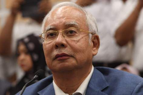 Malaysia seizes luxury bags, cash, jewelry in probe of ex-PM