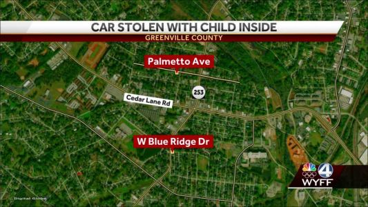 Car stolen with child inside, police say