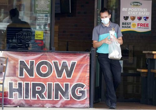 Seasonal hiring continues and jobless claims drop even as virus surge poses a future threat
