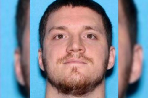 Manhunt for suspect in body armor and helmet after cop is fatally shot