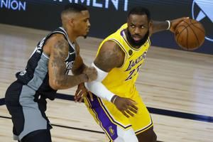 Kings sink 21 3s, roll to win as Lakers rest most starters