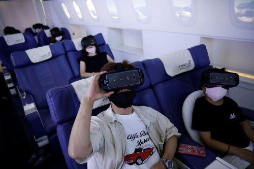 People in Japan are boarding fake planes to take virtual vacations around the world