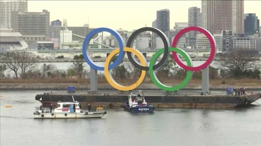 Olympic rings arrive in host city on barge into Tokyo Bay