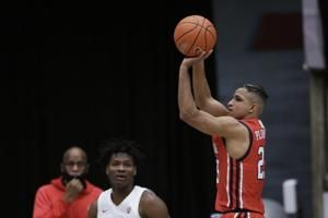 Carlson paces hot-shooting Utah past Washington State, 71-56