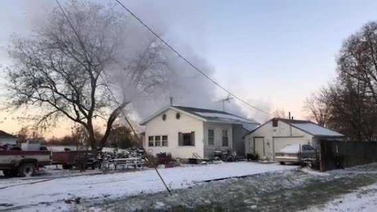 Crews battle flames, extreme cold at house fire