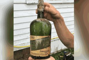 Couple finds Prohibition-era whiskey in walls of their home