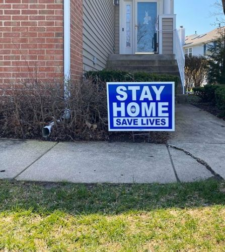 Suburban woman forced to remove 'Stay Home, Save Lives' sign over homeowners' association rules