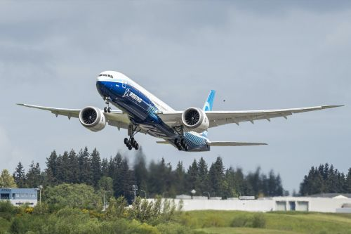 Boeing reports a record annual loss of nearly $12 billion and delays its 777X jet to 2023