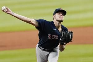 Houck, Vazquez grand slam lead Red Sox to 8-2 rout of Braves