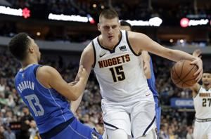 Jokic helps Nuggets beat Mavs as Doncic sits with sore ankle