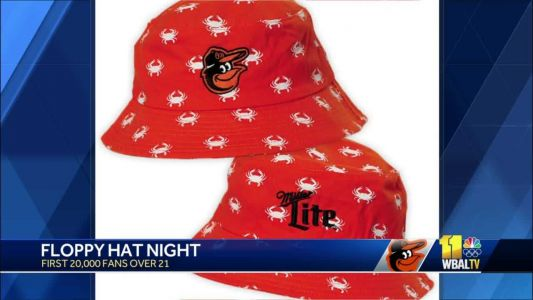 It's floppy hat giveaway night at Camden Yards