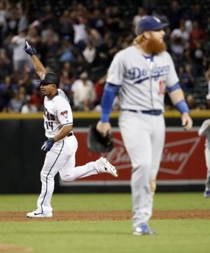 Escobar's home lifts D-Backs over Dodgers, tightens NL West