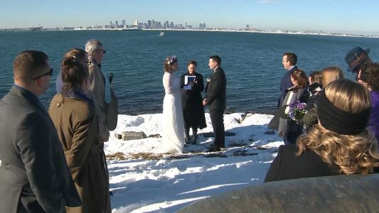 Couple gets married on snow-covered Deer Island in picturesque wedding