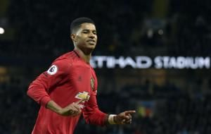 Man City beaten 2-1 by United in blow to title defense