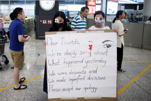 Protesters apologize after days of chaos at Hong Kong airport