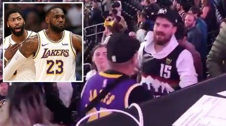 Granite chin: Denver Nuggets fan shrugs off HUGE punch during crowd fight after LA Lakers game