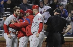 Harper angrily confronts ump, Phillies fall to Mets 5-1