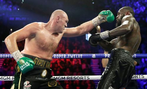 Tyson Fury beats Deontay Wilder in 7th-round TKO to win title
