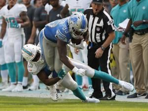 Bad run defense dooms Dolphins in loss to Detroit