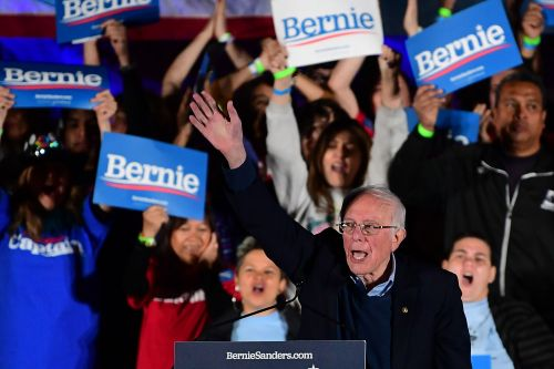 Democrats fear caucus chaos in Nevada as early returns show Sanders win