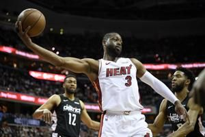 Dwyane Wade scores 20 points, Heat beat Wizards 113-108
