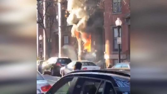 Family rescued from burning apartment building in Boston