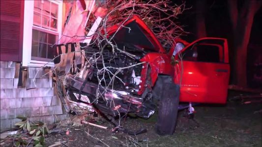 Driver arrested on OUI charges after crashing truck into home, police say