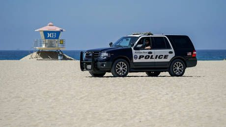 Protesters in Huntington Beach, California block traffic in defiance of new Covid-19 curfew