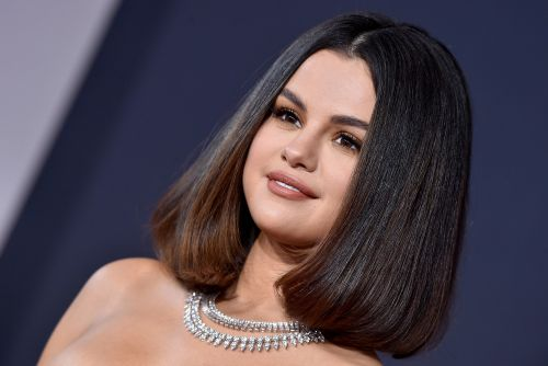 Selena Gomez unveils new cross tattoo