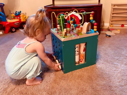 I bought this classic activity cube for my 9-month-old daughter - she still loves playing with it more than 5 months later