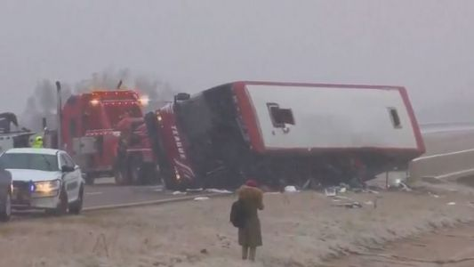 2 dead, 44 hurt in tour bus crash on icy highway ramp in Mississippi, authorities say