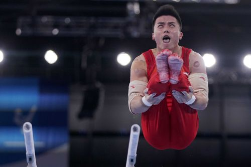 China takes early lead in men's gymnastics qualifying