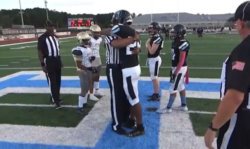 WATCH: Football player surprised during coin toss by Army dad dressed as referee