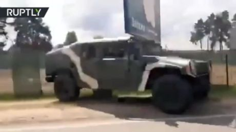WATCH military vehicles deployed near Minsk on Belarusian presidential election day after authorities warned of 'provocations'