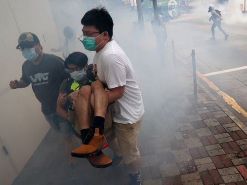 Hong Kong Police Fire Volleys of Tear Gas at Protesters