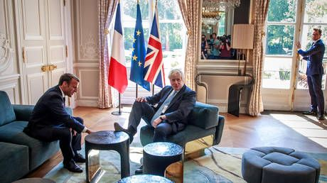 What's French for 'get your feet off my effing furniture'? BoJo slammed for 'disrespecting' Macron