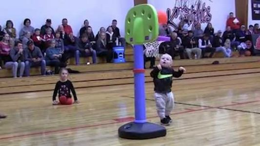 WATCH: Toddler thrills crowd at halftime of high school basketball game