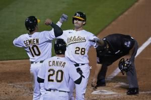 A's clinch playoff berth with win over Giants, Mariners loss