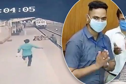 'Hero' rail worker in India saves boy from oncoming train, video shows