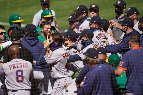 Baseball-Astros coach handed 20-game ban for brawl, A's Laureano gets six
