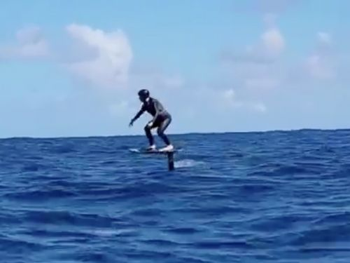 Photos reveal Mark Zuckerberg surfing while wearing an $84 bracelet that claims to fend off sharks