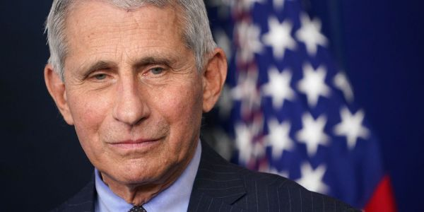 Fauci says the US won't change its vaccine strategy to delay second doses, unlike countries like the UK