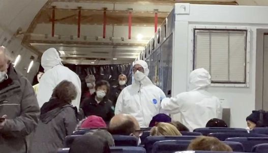 14 passengers on US charter flights evacuating quarantined cruise ship test positive for coronavirus